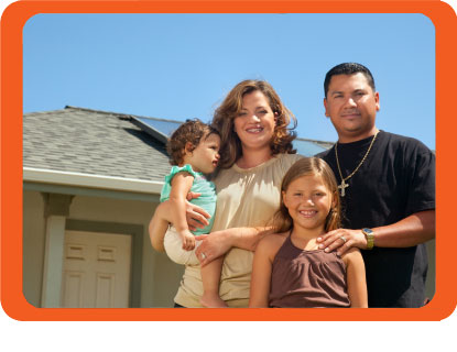 Hispanic family in front of their house