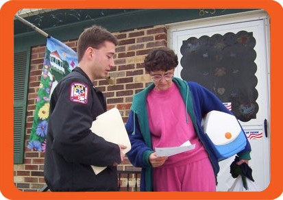 Fire Service with homeowner promoting fire prevention