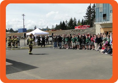 A fire department does a side by side burn demonstration to show how effective home fire sprinklers are
